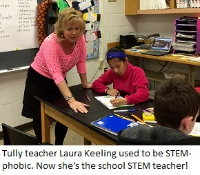 Tully Elementary teacher Laura Keeling works with students in her STEM lab.