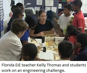 Florida EiE teacher Kelly Thomas and students work on engineering a model maglev train