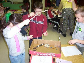 Kids exploring the properties of magnets